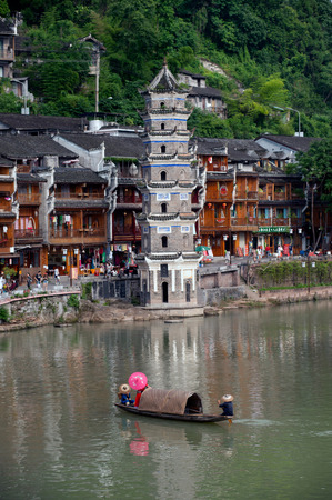 minority: Tujia minority singing show on river in Fenghuang old town . Stock Photo