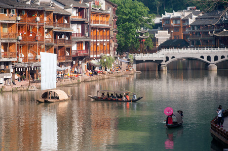 minority: Tujia minority singing show on river in Fenghuang old town . Editorial