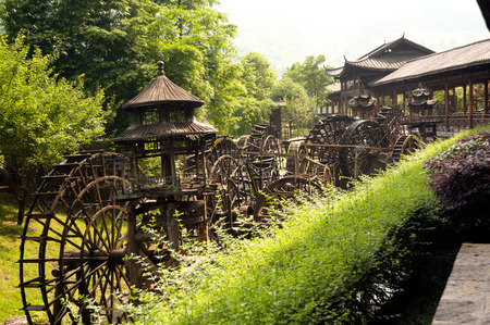 waterwheel: Wooden waterwheel front of Huanglong cave. Stock Photo