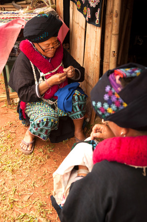 habiliment: Senior Mein Hill Tribe Minority embroidery her clothes in Thailand.