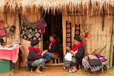 minority: Senior Mein Hill Tribe Minority embroidery her clothes in Thailand.