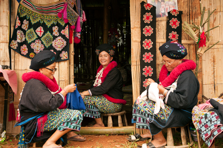 thailand culture: Senior Mein Hill Tribe Minority embroidery her clothes in Thailand.