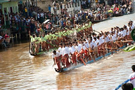 daw: Peoples paddle by legs racing in Phaung Daw Oo Pagoda festival,Myanmar.