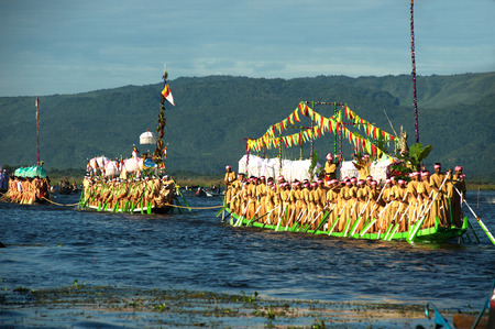 Peoples paddle by legs in Phaung Daw Oo Pagoda festival,Myanmar.
