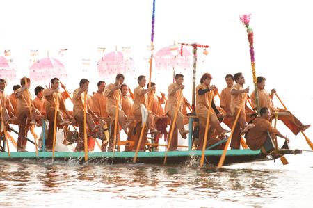 peoples: Peoples paddle by legs in Phaung Daw Oo Pagoda festival,Myanmar.