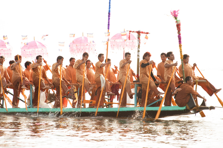 daw: Peoples paddle by legs in Phaung Daw Oo Pagoda festival,Myanmar.