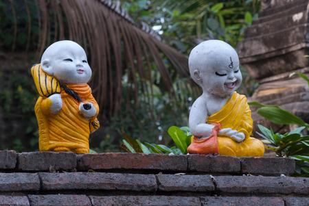 introspection: Monk dolls in Thai temple.