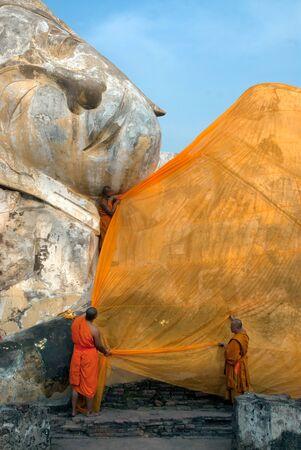 reclining: Reclining Buddha at Wat Lokayasutharam , Ayutthaya, Thailand.
