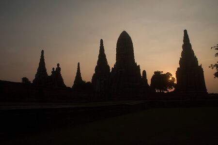 knowledge tree: Silhouette of Ancient Pagoda in Wat Chaiwatthanaram,Ayutthaya Historical Park of Thailand.