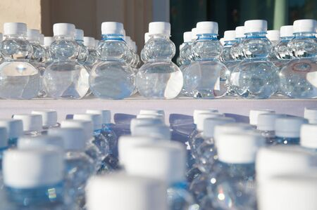 batch: Batch of plastic bottles of water. Stock Photo