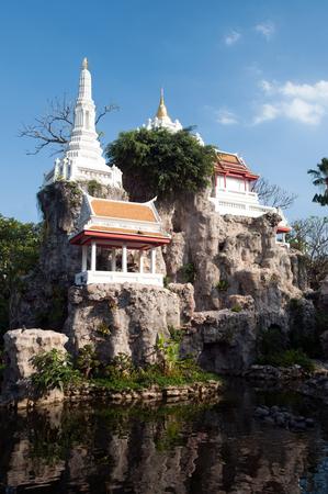 mococa: Khao Mo was built of stones.It look like a small mountain upper the small white pagoda. Located in Wat Prayurawongsawas Worawihan temple ,Thonburi, Bangkok, Thailand. Stock Photo