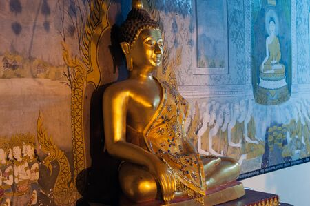 venerate: Buddha at golden Pagoda of Wat Phra That Doi Suthep,The temple is founded in 1383 when the first stupa was built. Located in Chiang Mai Province,Thailand.
