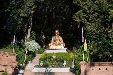 venerate: Large monk statue at golden Pagoda of Wat Phra That Doi Suthep,The temple is founded in 1383 when the first stupa was built. Located in Chiang Mai Province,Thailand.