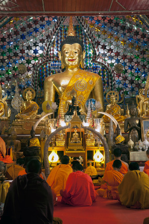 venerate: Ancient sitting Buddha at golden Pagoda of Wat Phra That Doi Suthep,The temple is founded in 1383 when the first stupa was built. Located in Chiang Mai Province,Thailand.