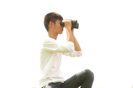 using binoculars: Asian young boy using binoculars .