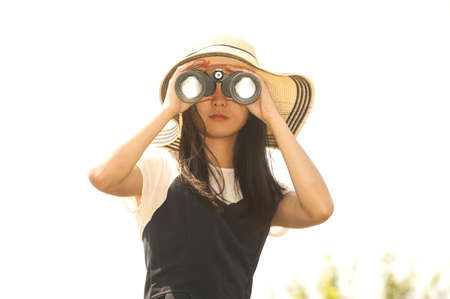 using binoculars: Pretty Asian young  woman using Binoculars .