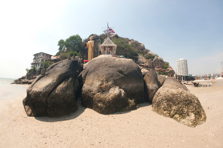 foothill: Large Buddha statue standing with a height 16 meters,located at the foothill in Wat Khao Takiab,Hua-Hin beach,Prachuap Khiri Khan.