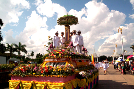 flower parade: People holding traditional candle on parade of Tak Bat Dok Mai Merit Flower Festival in Thailand. Editorial