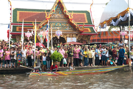 Group of peoples wait and throwing lotus to the boat on Rub Bua Festival,Thailand. Editorial