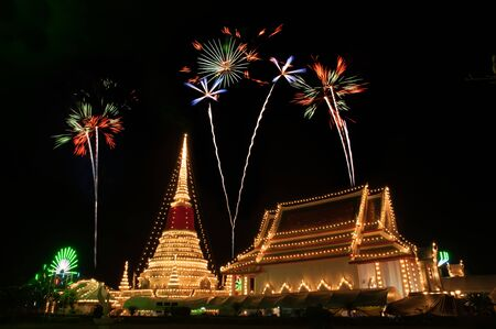 Colorful firework on night at Phra Samut Chedi Pagoda in Thailand.