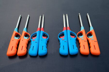 gas lighter: Group of colorful Gas lighter gun for gas-stove on a black background.