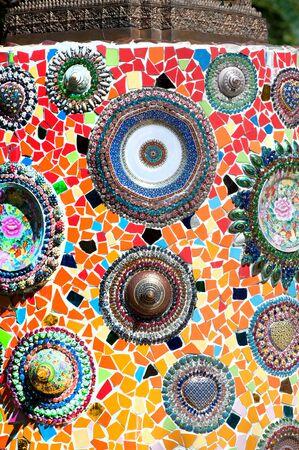 Hand made circular mosaic on Thai Buddhist Temple wall. Editorial