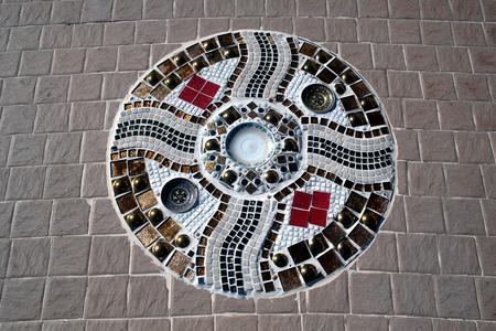 mosaic floor: Hand made circular mosaic on Thai Buddhist Temple floor.