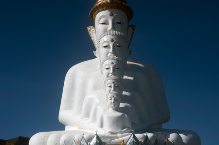 Face of Large outdoor Buddha statue on Khao Kho mountain at Wat Pha That Phra Sorn Kaew temple.