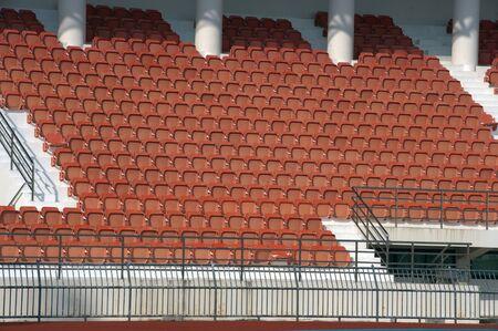 Orange color of stadium seats in background.