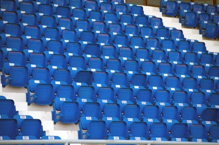 Blue color of stadium seats in background.