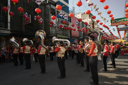 cerebrate: Marching band in a parade during Chinese New Year Festival.