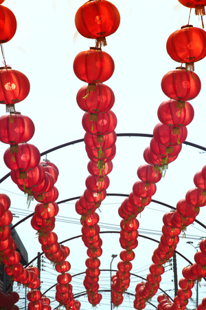 Colorful red Chinese lanterns hanging for Chinese New Year Festival. Stock Photo