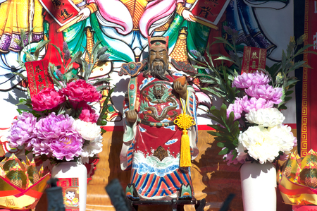 Statue of Chinese God Guan Yu on altar table. Editorial