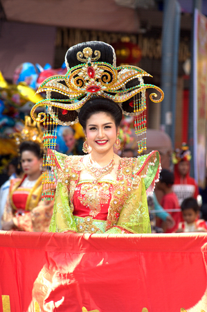 Pretty girl in traditional dress in Marching band in a parade during Chinese New Year Festival.