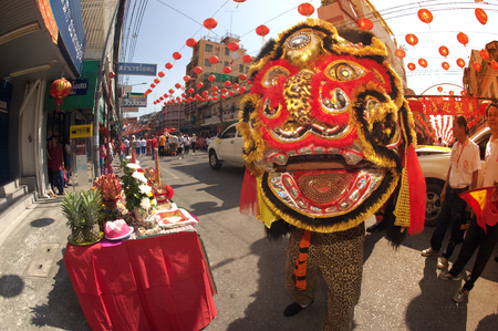 Lion dancing performers during the celebration,Of Chinese New Year in Thailand.