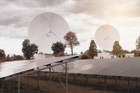 satelite: View of Solar Panel and a big long range communication antenna. Stock Photo