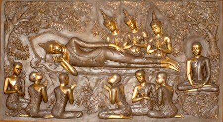 reclining: Detail at the base of the Reclining Buddha in the Wihan of Wat Pa Phu Kon,Thailand.