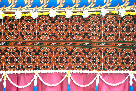 Traditional Thai art fabric decorated on the car in the Rocket Festival parade show.