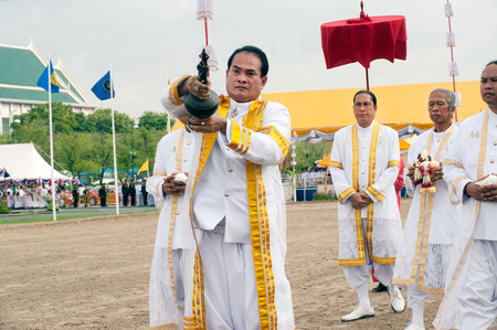 BANGKOK, THAILAND - MAY 13,2015 : Unidentified Government officials scatter the water attend the ceremony -Perform for an auspicious beginning for planting season on the Royal Plowing Ceremony on May 13,2015 in Bangkok city