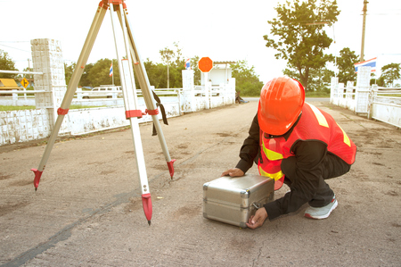 The Surveyor brought the theodolite to the box at work. Stock Photo - 80526055
