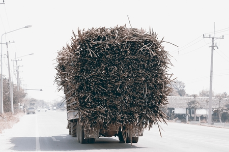 Fully loaded Sugarcane Truck in a highway in Thailand. Stock Photo