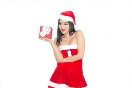 sexy asian woman: Female in red dresses Santa Claus holding a gift on isolated background.
