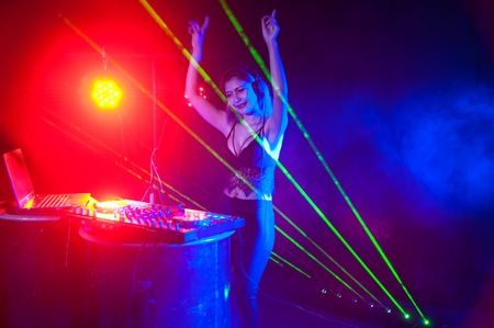 thai dancing: Pretty Asian female woman DJ playing music for dance. Stock Photo