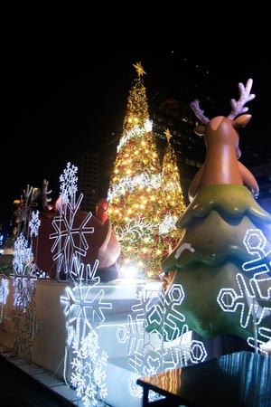 Bangkok , Thailand - November 22,2017: Santa statue and light decorate beautiful on Christmas Tree Celebration 2018 at Central World Department store for Christmas day and Happy New Year  event on November 22,2017 in Bangkok capital city.