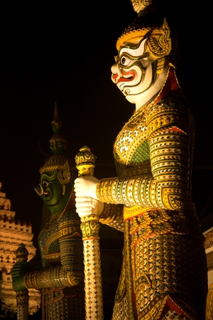 Night scene of Thai Giant guardian at front entrance of the -Ordination Hall- in Wat Arun Ratchawararam temple ,Bangkok,Thailand. Stock Photo