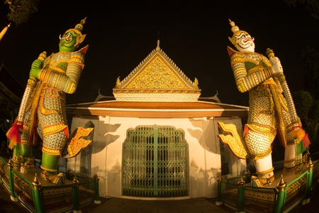 Night scene of Thai Giant guardian at front entrance of the -Ordination Hall- in Wat Arun Ratchawararam temple ,Bangkok,Thailand. Editorial