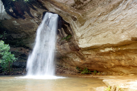 Sang Chan Waterfall is sometimes called Namtok  Long Ru ( Waterfall Through a Hole ).Located Ubon Ratchathani Province,Thailand. Stock Photo