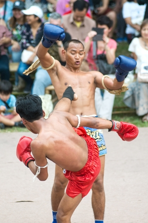 BANGKOK,THAILAND-JANUARY 21,2018 : Unidentified fighter of Martial art of Muay Thai ( Thai boxing ) showing in participants take part in the celebration of Thailand tourism festival at Lumpini park. Editorial