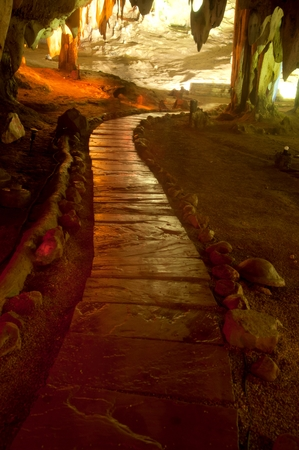 Footpath in the colorful limestone formations at Khao Bin Cave in Thailand.