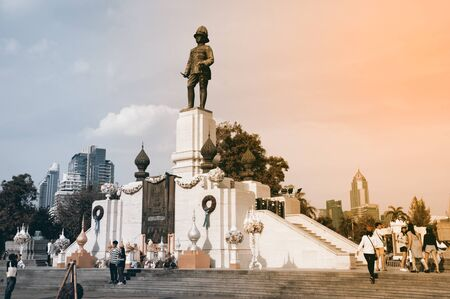 Bangkok, Thailand - January 28, 2017 : The King RAMA VI Monument in front of Lumpini park in a landmark and center of business district and skyscrapers building in Bangkok capital city, Thailand. 스톡 콘텐츠 - 135343813